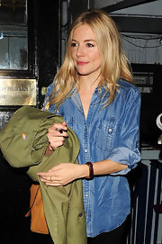 Sienna donned a denim button down while leaving her performance in 'Flare Path.'