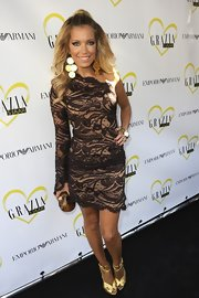 Silvie Van Der Vaart stunned in a sheer one-shoulder lace dress at the Grazia Magazine Party.