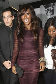 Alexandra Burke showed off her wavy locks while hitting the D&G party.