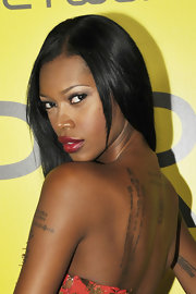 Jessica White showed off the intricate lettering tattoo on her back left shoulder at the Pre BET dinner.