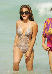 Christina was all smiles in Miami wearing this snakeskin monokini.