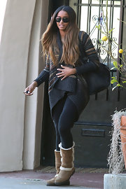 Ciara kept warm in a cozy sweater and tan sheepskin boots.