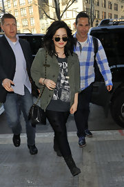 Demi Lovato chose a hip utility jacket to pair over a graphic tee and jeans while out in NYC.