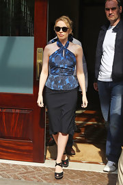 Kylie Minogue toughened her street attire with black suede Rive Gauche platform wedges with crisscrossing straps.
