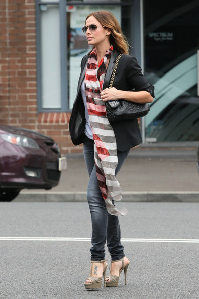 Natalie Imbruglia wowed on the streets of Sydney in a chic black boyfriend blazer teamed with skinny jeans and a long striped scarf.
