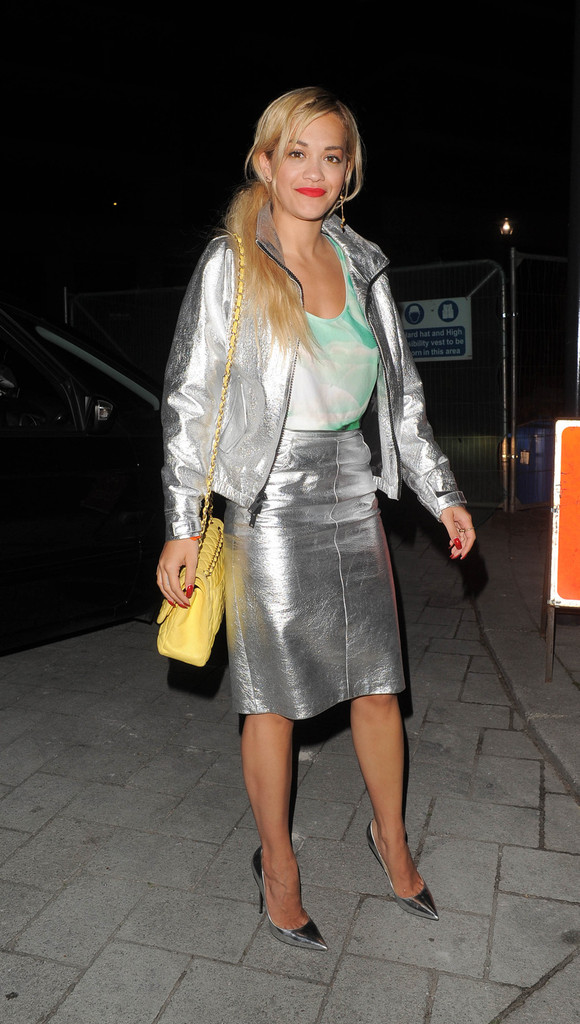 Singer Rita Ora, wearing a silver leather skirt and jacket, seen leaving a studio in London.