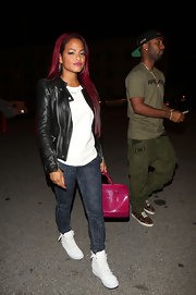 Christina Milian rocked a classic leather jacket while out with her boyfriend.