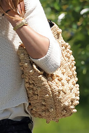 Olivia Palermo walked her dog in NYC with a Gerard Darel 24 Hour Woodstock raffia bag slung over her shoulder.