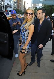 Paris Hilton kept her look coordinated, with classic black pumps finishing off her wildly printed shift.