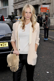 Poppy Delivigne gave her minimalist blazer and slacks the boho treatment with a fringed suede purse.