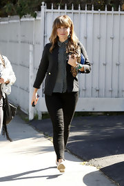 Sophia Bush paired a classic black blazer over her patterned blouse for a cool and sophisticated look.