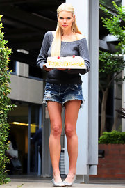 Sophie wore a pair of cutoff denim shorts with an off-the-shoulder sweater and flats.