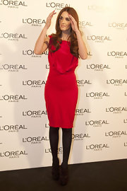 Paz paired her haute red frock with black leggings and platform strappy sandals.