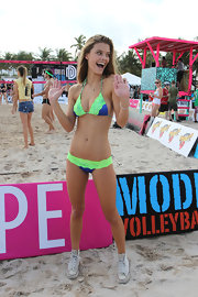 Sports Illustrated model Nina Agdal wore this green and blue string bikini for the 'Model Beach Volleyball' event in Miami.