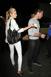 Newest Dancing with the Stare contestant Erin Andrews is seen out at a restaurant with fellow dancer Makism. She was seen carrying a stylish black leather bag with a chain strap.