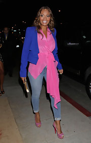 Evelyn Lozada went out for an evening in Los Angeles wearing a pair of vibrant pink peep toe pumps with colorful embellishments.
