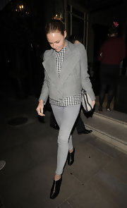 Stella McCartney looked sharp in a checkered blazer with broad lapels.