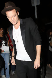 Shane West made a satin-lapel black suit jacket look casual by pairing it with a plain shirt and scrunching up the sleeves.