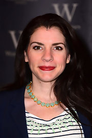 Stephanie Meyer dressed up her casual look with a bright red lip.