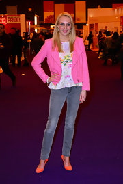 Camilla Dallerup chose a hot pink motorcycle jacket for her fun and feminine look while out in London.