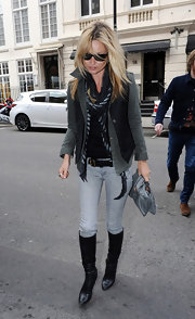 Kate Moss headed out for lunch in London wearing a sleek pair of black leather knee-high boots.