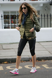 Elle was spotted in London after dropping her kids off at school. She kept comfy with pink and white running shoes.