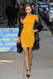 Irina topped off her saffron dress with platform sandals.