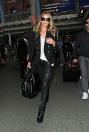 Rosie Huntington-Whiteley was spotted in London looking rocker-chic in a double-breasted Balmain blazer and leather pants.