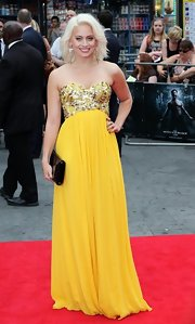 Kimberley Wyatt chose a bold, canary yellow gown with an embellished bodice and flowing skirt for the premiere of 'The Wolverine.'