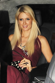 Paris Hilton arrived in Cannes looking casual with her long hair simply styled in straight layers.