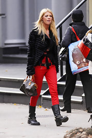 Tara Reid was spotted on a stroll through Soho in a textured fur jacket and bright red pants.