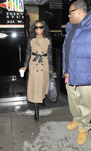 Tatyana Ali sported one stylish trenchcoat with leather sleeves and a matching belt.