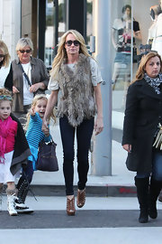 Despite the winter chill, Taylor Armstrong hit the streets in decidedly summery brown sandals.
