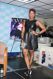 Fantasia Barrino matched her leather dress with a pair of chunky heels.