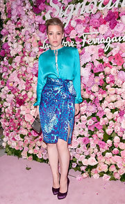 Piper Perabo attended the launch of Salvatore Ferragamo's Signorina fragrance wearing a pair of purple satin pumps.