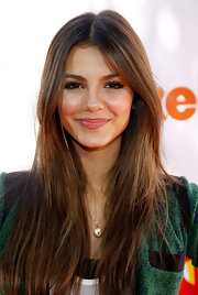 "Dewy makeup accentuated Victoria Justice's luminous skin when she attended the Los Angeles premiere of ""Fred: The Movie."""