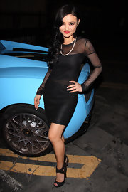 Tila poses in a sheer little black dress at Bardot Lounge.