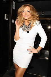 Tila Tequila paired her curve hugging white dress with a silver statement necklace.