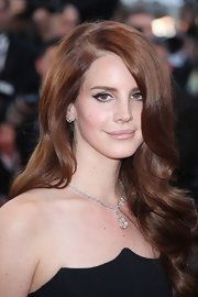 Lana Del Ray arrived at the opening ceremony of the Cannes Film Festival wearing an 18-carat gold necklace set with a large yellow pear-shaped diamond drop and a pair of diamond stud earrings.