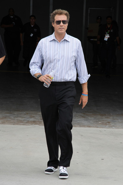 Will Ferrell paired his black slacks with a blue and white button down shirt.