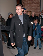 Tom Cruise looked dapper in a black pea coat out in NYC.