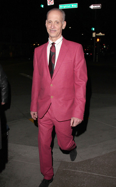 John Waters' pink suit showed his quirky personality and sense of style while out in LA.