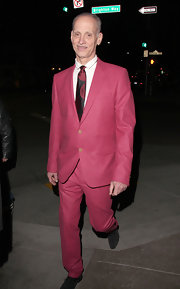 John Waters' funky dotted tie added some pizazz to his already quirky suit.