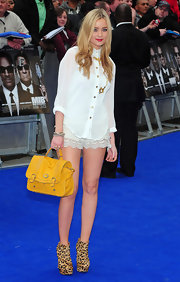 Laura Whitmore paired her ivory ensemble with an edgy pair of animal print ankle boots.
