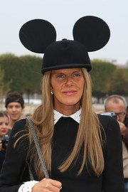 The Queen of Wacky Hats, Anna dello Russo, struck again during Paris Fashion Week, where she wore this quirky Comme des Garcons Mickey Mouse cap.