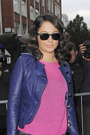 Tulisa exuded attitude in a slick black pair of shades.