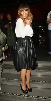 Rebecca Ferguson's black leather skirt added just a tad of edginess to her conservative look.