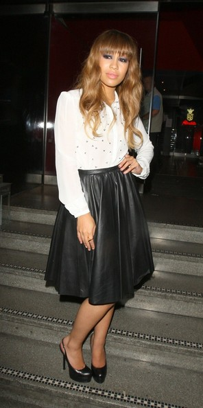 Rebecca Ferguson looked modest in a dotted white button-down and a flare skirt during a night out at the Freedom Bar.