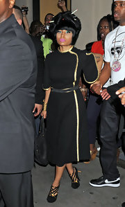 During Fashion's Night Out in NYC, Nicki Minaj stayed stylish in an LBD with dramatic gold piping.