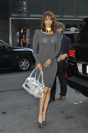 A metallic tote added a futuristic element to Tyra's 'Good Morning America' look.